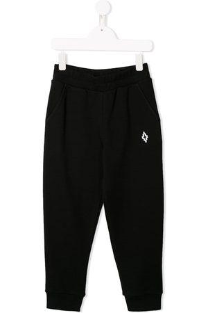 MARCELO BURLON Cross logo track pants