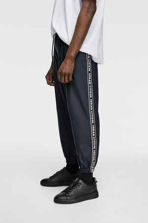 Zara Technical trousers with slogan-printed taping