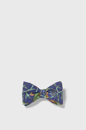 Zara Vlinderdas met tropische print