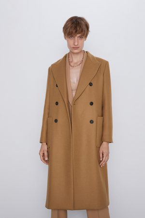 Lange jas met zakken