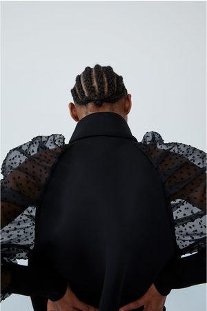 Zara Vest met plumetismouwen