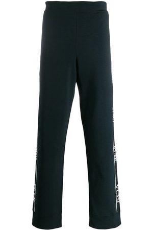 VALENTINO Side panelled VLTN track pants