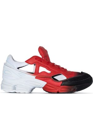 adidas X Raf Simons and black Ozweego cut out sneakers