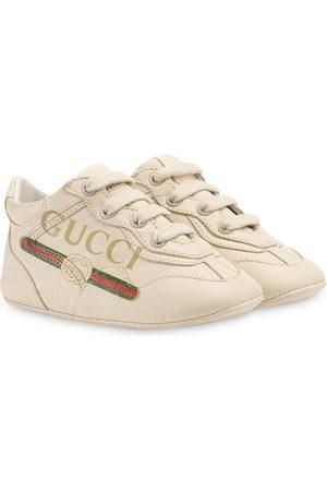 Gucci Rhyton logo print sneakers