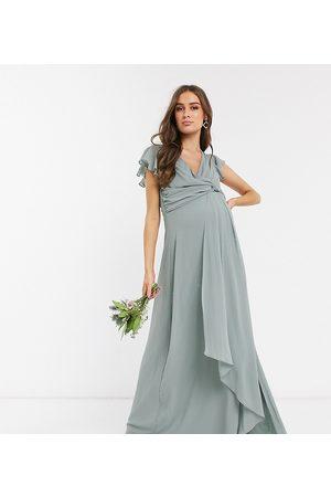 TFNC Bridesmaid flutter sleeve ruffle detail maxi dress in sage-Green