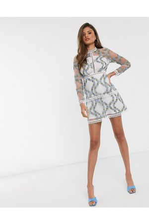 ASOS Long sleeve tiered mini dress in blue embroidered floral mesh in white base-Multi