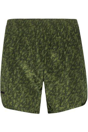 TRUE TRIBE Wild Steve camo print swim shorts