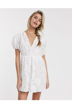 Skylar Rose Tea dress with fitted waist in textured floral-White