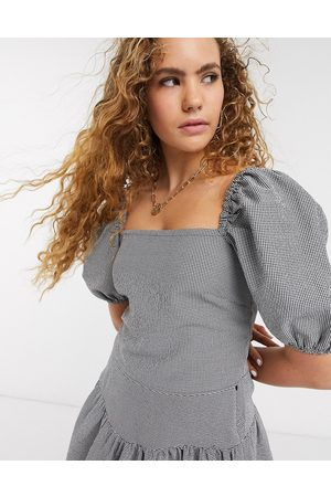 & OTHER STORIES Check puff sleeve blouse in black and beige