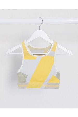 Nike Icon Clash seamless bra in yellow print