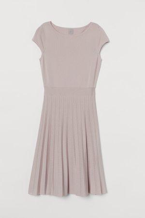 H&M Fijngebreide jurk