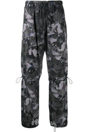 MARCELO BURLON High-rise camouflage-print track pants