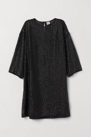 H&M Dames Glitterjurken - T-shirtjurk met pailletten