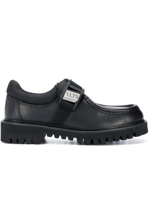 VALENTINO Chunky loafers with logo buckle detail