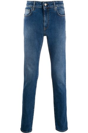 Moschino Double Question Mark slim-fit jeans