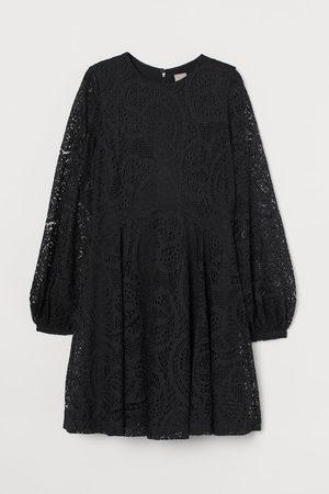 H&M Kanten jurk met cirkelrok