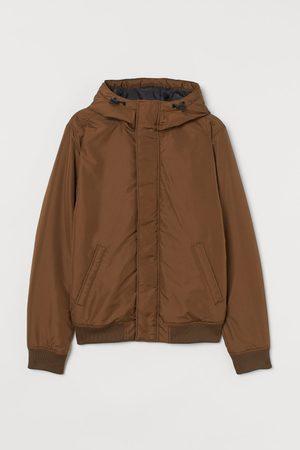H&M Gewatteerde jas met kap