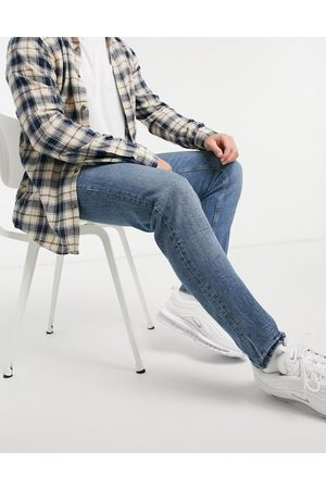 ASOS Stretch tapered jeans in vintage mid wash with tint-Blue