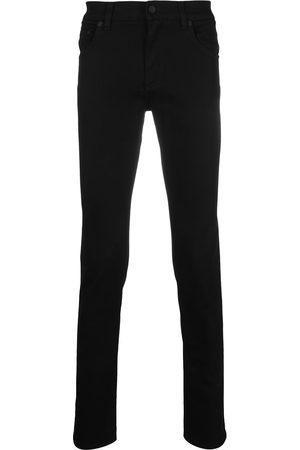 Dolce & Gabbana Logo-embossed skinny jeans