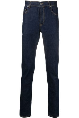 Moschino Question mark embroidered jeans