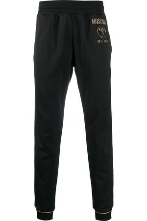 Moschino Logo plaque track pants