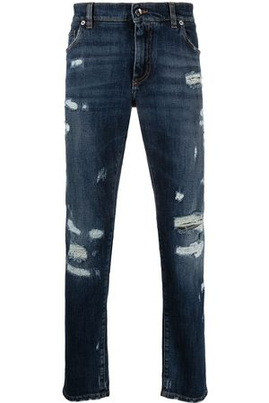 Dolce & Gabbana Heren Slim - Embossed logo ripped slim-fit jeans