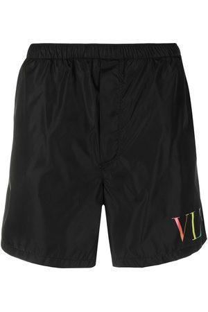 VALENTINO VLTN-print swim shorts