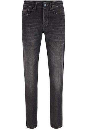 HUGO BOSS Zwarte superelastische tapered-fit jeans en iriserende details
