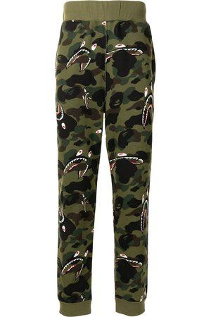 A BATHING APE® Shark camouflage-print track pants