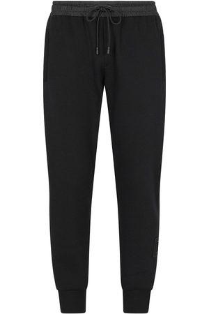 Dolce & Gabbana Heren Joggingbroeken - Logo-print tapered-leg track pants