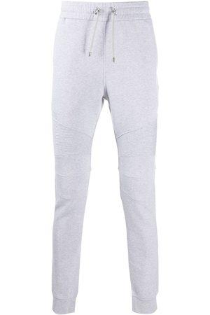 Balmain Heren Joggingbroeken - Logo-print ribbed track pants