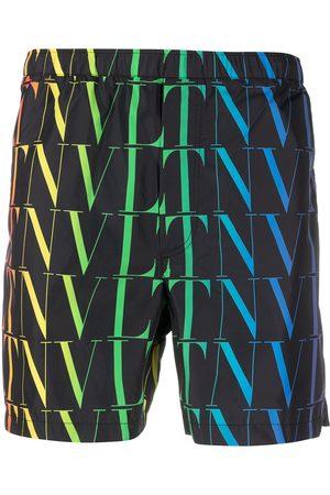 VALENTINO VLTN logo-print swimming shorts