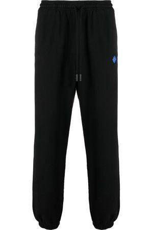 MARCELO BURLON Geometric-pattern track pants