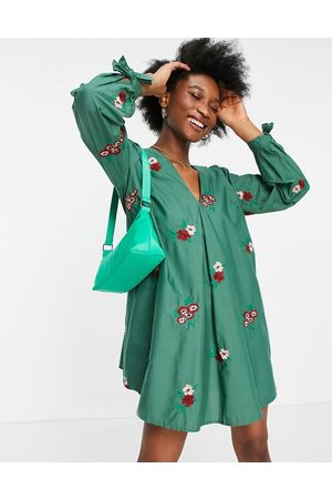 ASOS Cotton poplin v front v back trapeze mini dress in all over floral embroidery in green