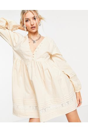 ASOS Cotton poplin button neck mini smock dress with tie sleeves and lace inserts in stone-Neutral