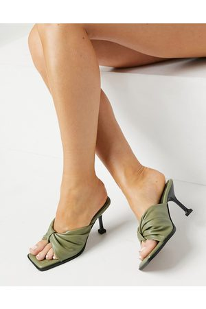 ASOS Haggan padded bow heeled mules in oilve-Green