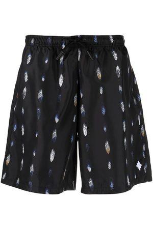 MARCELO BURLON Heren Shorts - Feather-print swim shorts
