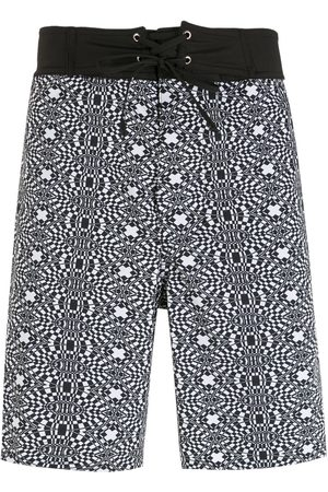 AMIR SLAMA Heren Shorts - Striped geometric print shorts