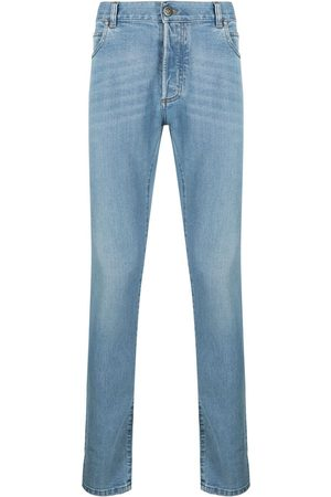 Balmain Embroidered-monogram slim-fit jeans