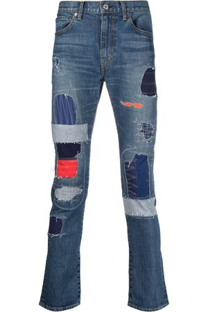 JUNYA WATANABE Heren Slim - Patchwork slim-fit jeans