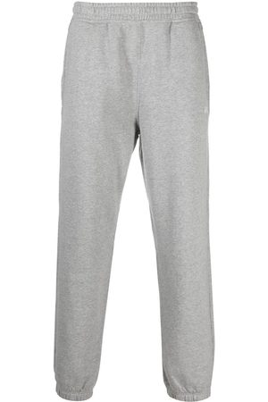 STUSSY Overdyed stock logo track pants