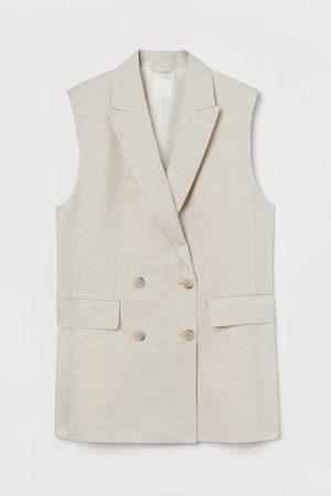 H & M Mouwloze blazer van linnenmix