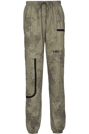 HELIOT EMIL Camouflage-print track pants