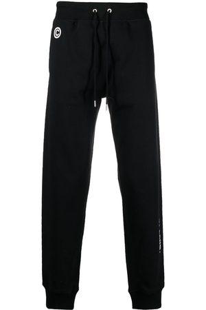 Helmut Lang Impress slogan-print track pants