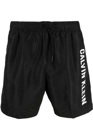Calvin Klein Logo-printed swim shorts