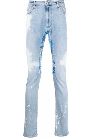 Alchemist Distressed-effect denim jeans