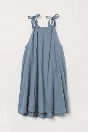H&M Mouwloze jurk