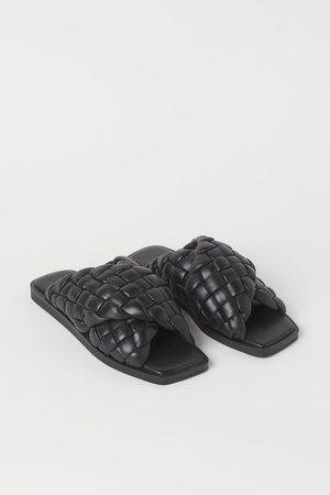 H&M Gevlochten leren slippers