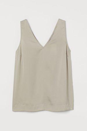 H & M Dames T-shirts - Satijnen top met V-hals