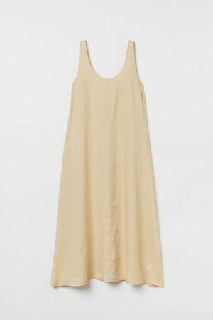H&M Uitlopende linnen jurk